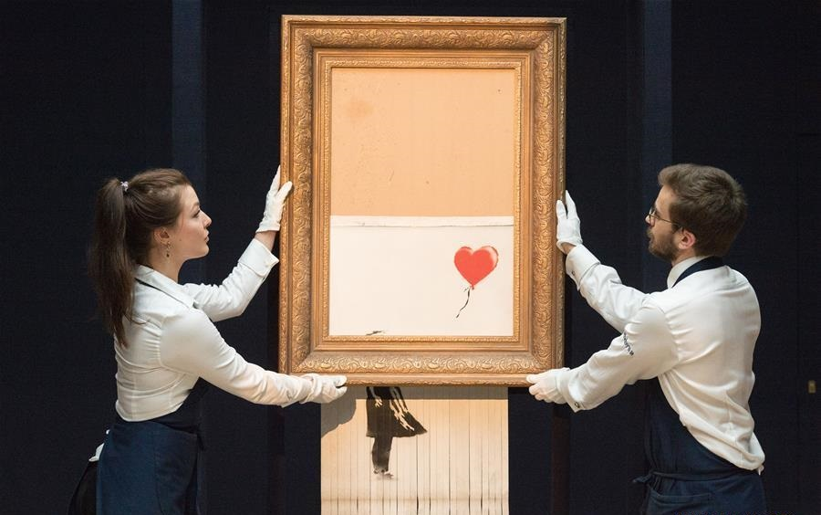Banksy Banksy's Girl With Balloon right after self destructed in Sotherby´s auction in November 2018