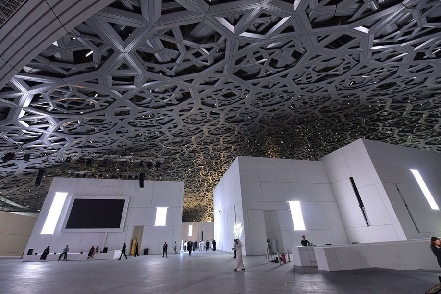 A general view of the Louvre Abu Dhavi Museum building designed by French architect Jean Nouvel on November 8, 2017 during its inauguration on Saadiyat island in the Emirati capital. its doors bringing the famed name to the Arab world for the first time.